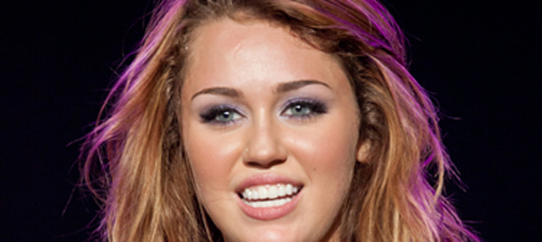 HollywoodNews.com: Miley Cyrus is apparently going to carry on as if she